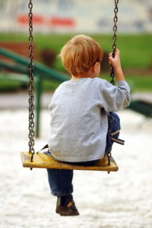 Lonely-child on swing